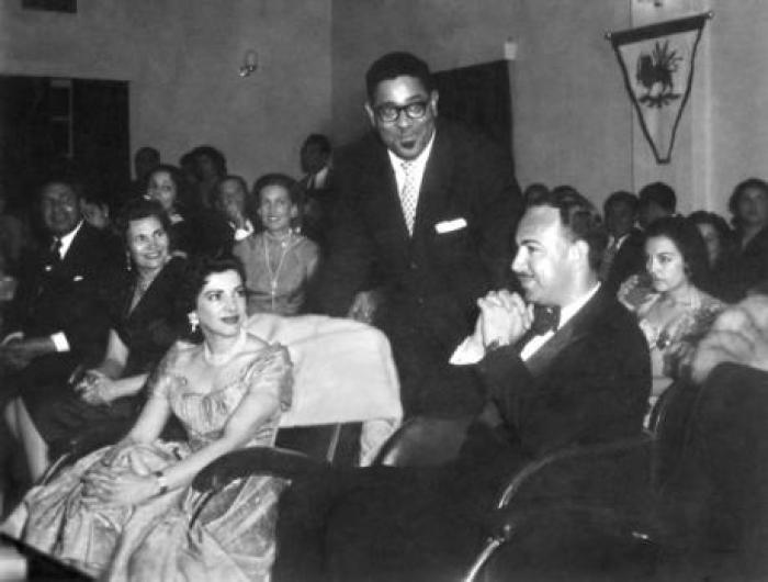 Jazz legend Dilly Gillespie  poses at a function in Abadan with Princess Shams Pahlavi, the sister of the Shah, in 1956
