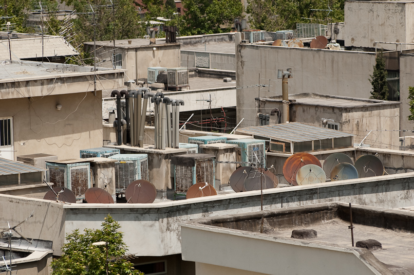 Satellite dishes on a Tehran rooftop. Photo: Kamyar Adl (detail)