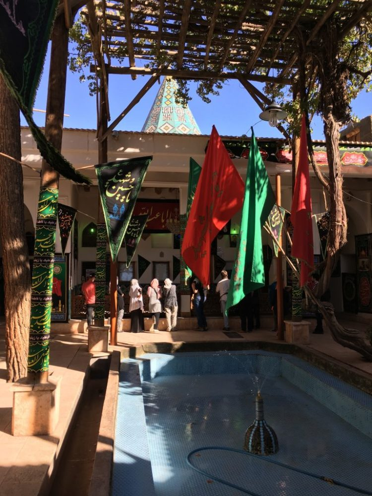 French tourists learn about Ashura at an Imamzadeh in the village of Abyaneh outside of Kashan.