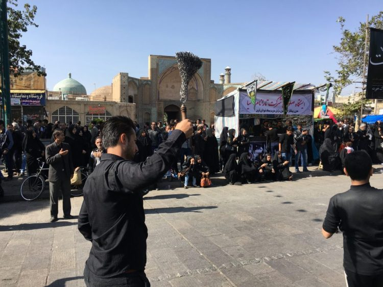 On the day of Ashura, the processions take to the streets all day. Pictured: man in mourning, hitting his back with a set of chains as part of the procession in Qazvin.