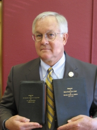 Retired Judge Darrell White with Bibles