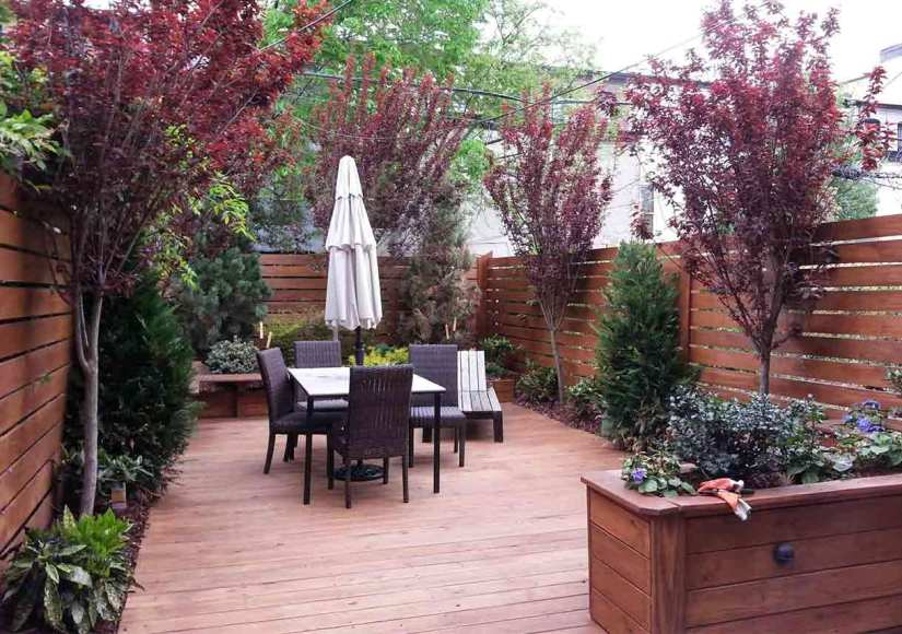 How do you make a small backyard look bigger?