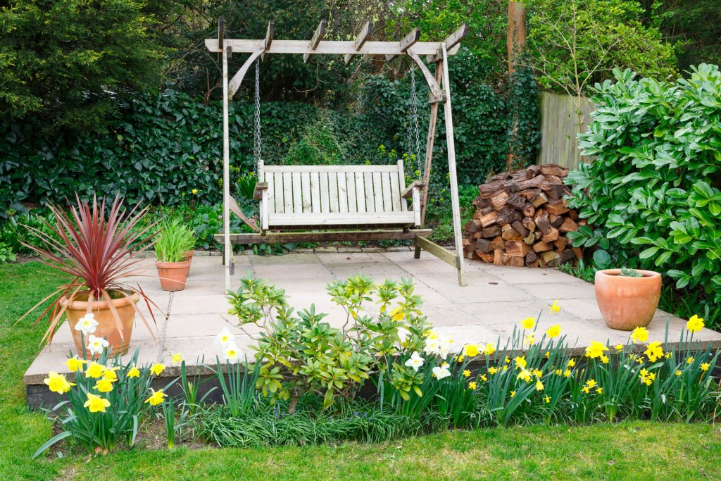 Wooden porch swing in a garden