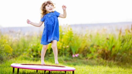 Child jumping on trampoline feature image