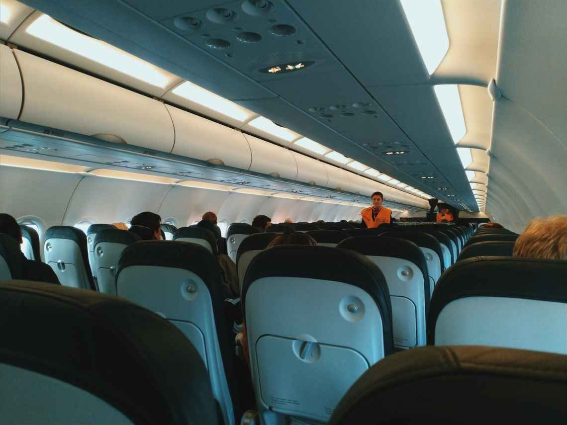 cabin of aircraft with passengers on board