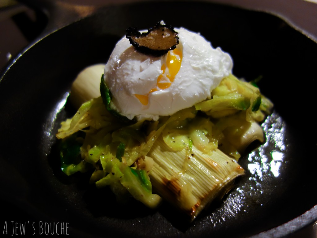 Braised leeks and fried brussels sprouts with poached egg and black truffle