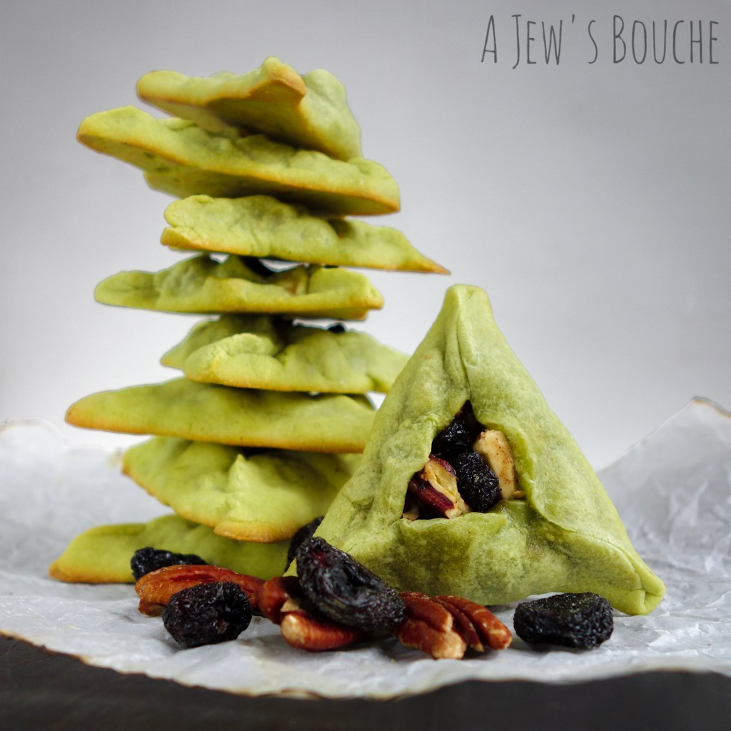 MATCHA HAMANTASCHEN WITH WHITE CHOCOLATE, TOASTED PECANS, AND SAKE-INFUSED BING CHERRIES