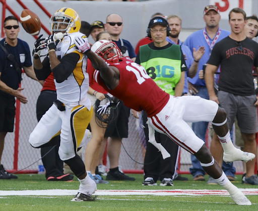 Nebraska cornerback Stanley Jean-Baptiste, right, breaks up a pass intended for Southern Mississippi wide receiver Rickey Bradley (81) in the first half of an NCAA college football game in Lincoln, Neb., Saturday, Sept. 7, 2013. (AP Photo/Nati Harnik)
