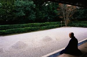 Monk Meditating at a Rock Garden