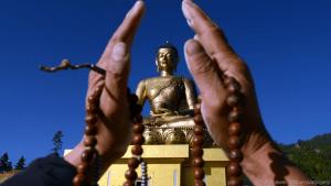 A devotee before the Buddha Dordenma statue in Thimphu. (Credit: Prakesh Mathema/AFP/Getty)
