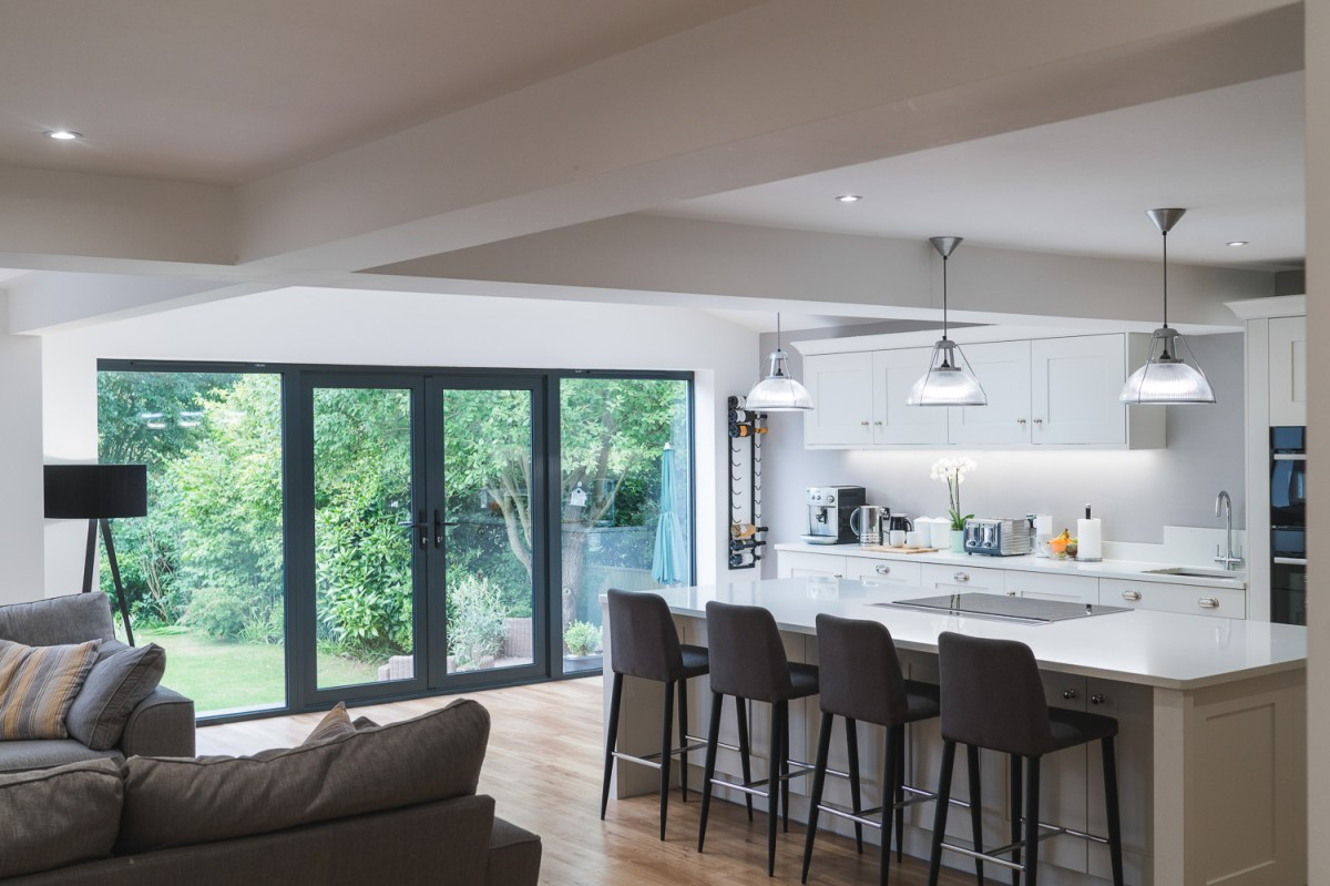 House remodelling in Bexhill by AJ Hammond Builders renovated this kitchen with rear glass doors