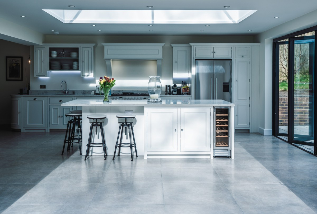 AJ Hammond Builders house renovation with designer kitchen and bespoke design, with white ceiling beams by builders in Bexhill, East Sussex