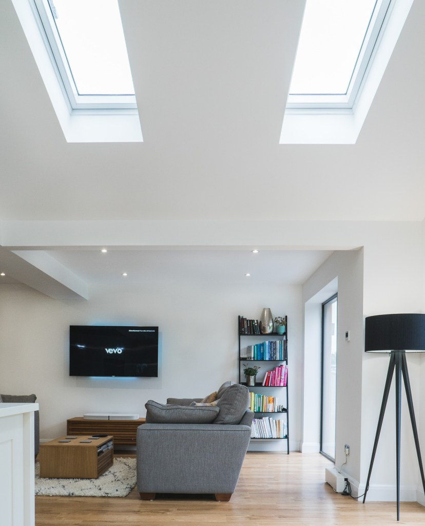 Ceiling skylight windows over a rear kitchen extension. This house extension in Bexhill On Sea was built by AJ Hammond Builders