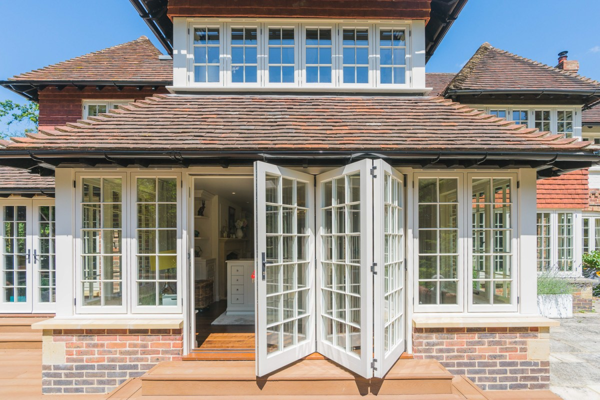 AJ Hammond Builders white bifold doors, a modern house extension and renovation in Heathfield, East Sussex