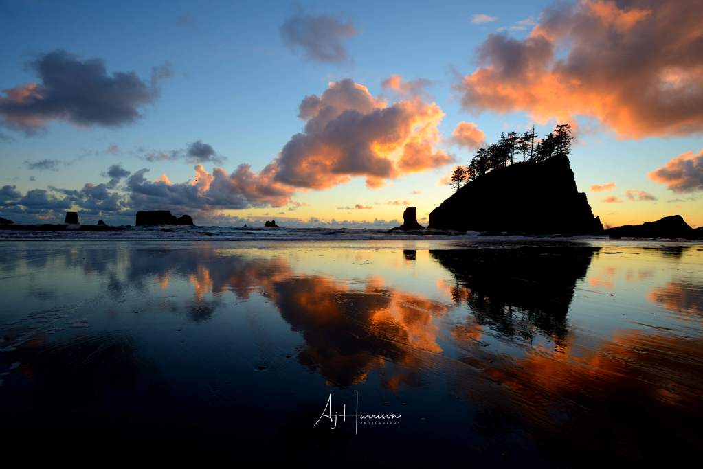 Sunset behind the sea stacks of Ruby Beach, Olympic National Park, Washington State.