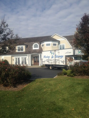 AJ Moving Truck Preforming Residential Moving Long Island