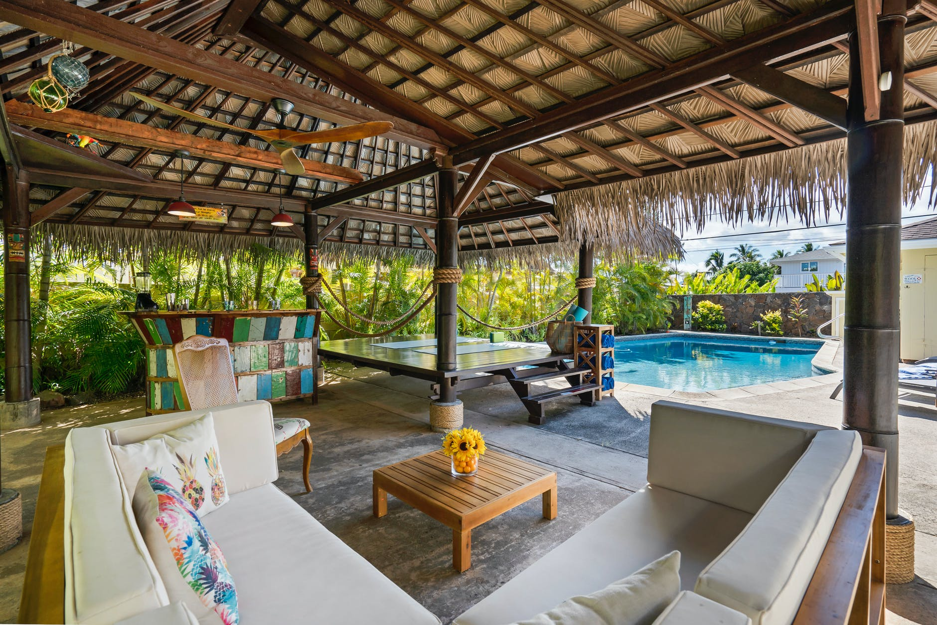 a cozy cabana close to a swimming pool
