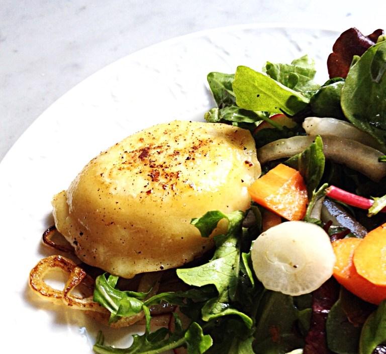 Photo of Cheese and Potato Pierogi with a side salad.