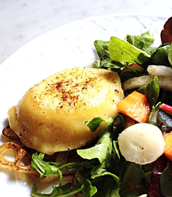 Photo of Cheese and Potato Pierogi with a side salad.