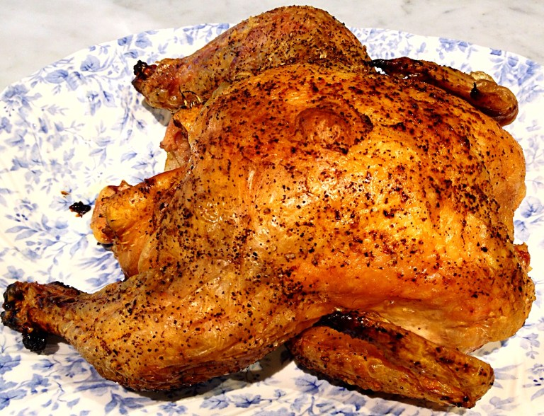 photo of grilled, whole chicken