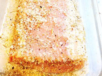 Photo of pork loin marinating in dry rub