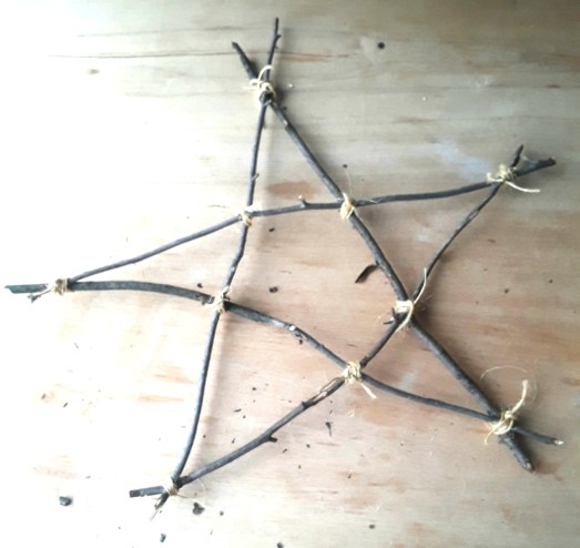 Star made from tree branches tied with twine