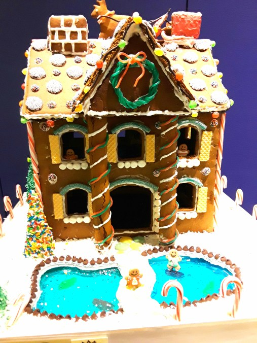 Two story gingerbread house with jelly front pond and vanilla wafer shutters