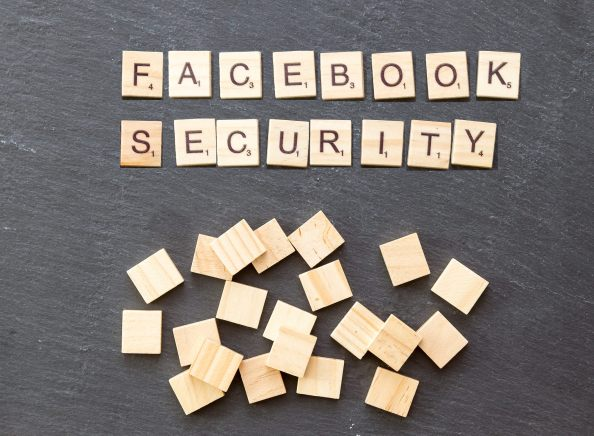 "wooden tiles spell out ""Facebook Security"""