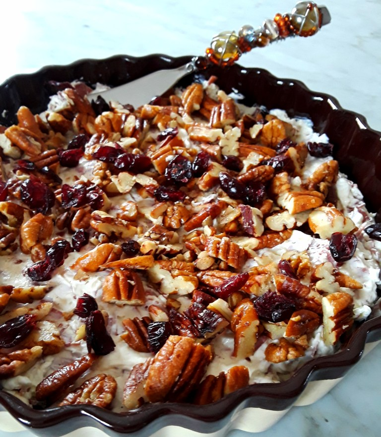 toasted pecans and dried cranberries top cream cheese beef dip