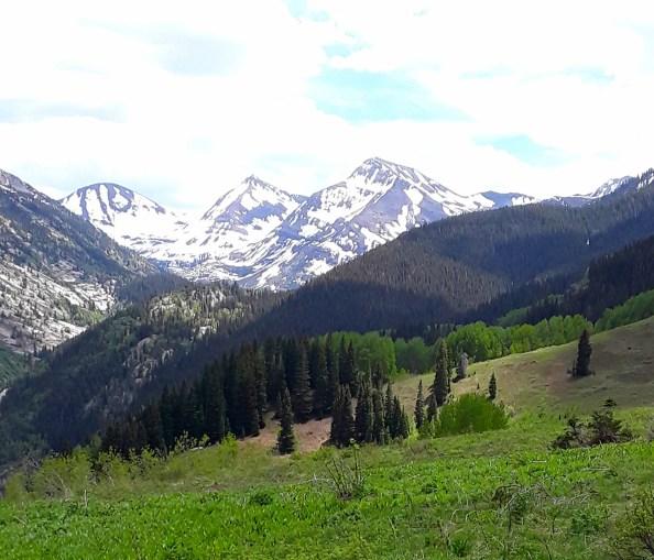 Three snow covered mountain peaks
