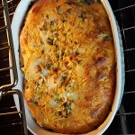 the baked casserole is golden brown and puffy