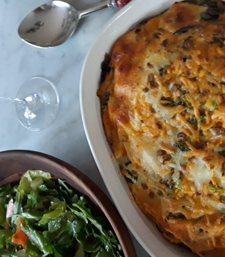 egg casserole dinner with side salad and white wine