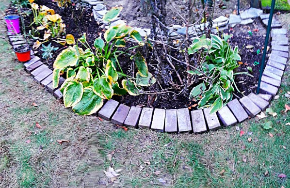 bricks laid lengthwise as a border for a bed