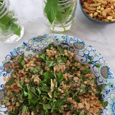 serving bowl with blue paisley pattern heaping with lentils and herbs