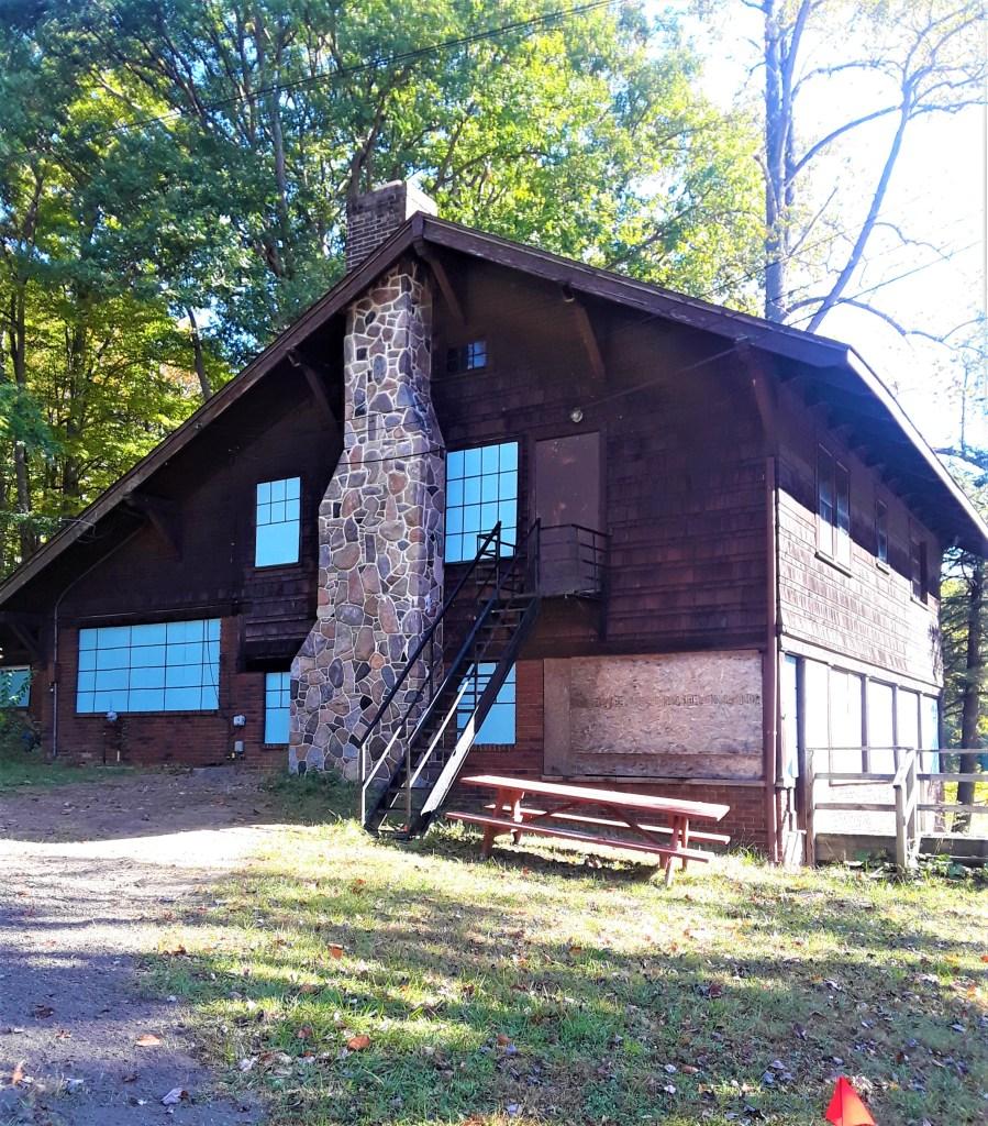 Kirby House sided in dark wood