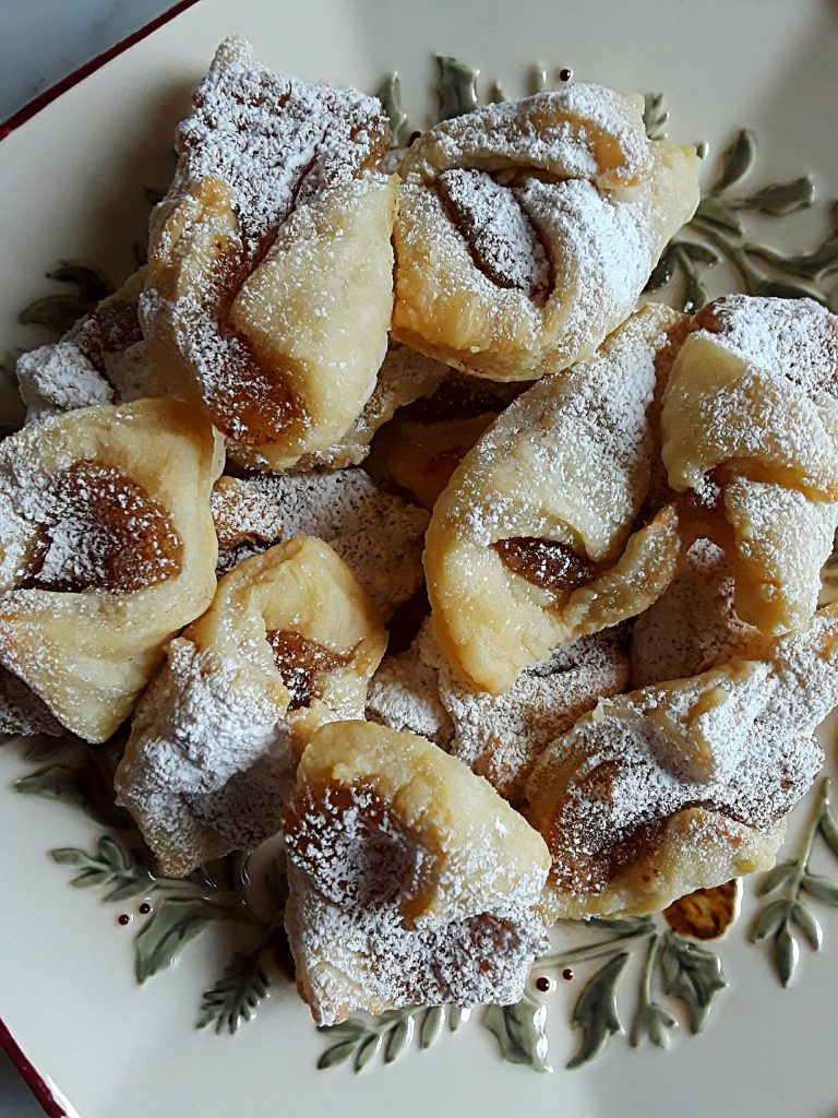 kolachki cookies are dusted with confectioner's sugar