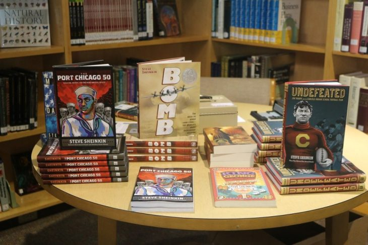 Display of new books ob maple table in the bookstore