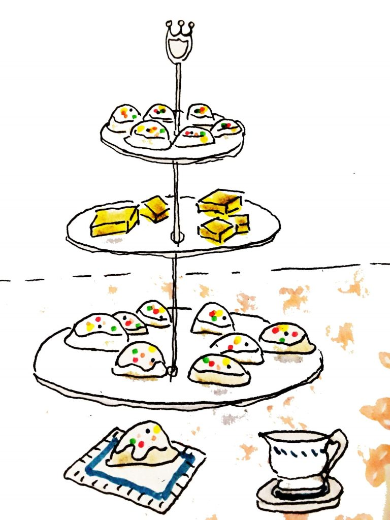 A three-tier tray displays lemon squares and ricotta cheese cookies.