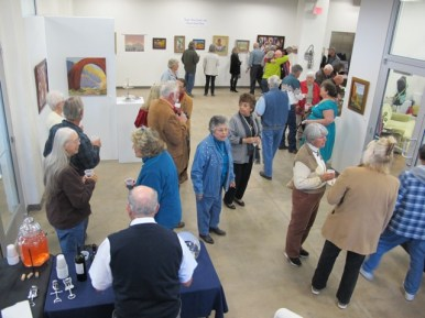 Early visitors had room to move around but the gallery quickly filled up.