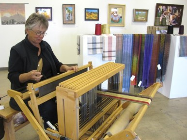 Weaver Jolene Northup brought her loom and several pieces of finished work.