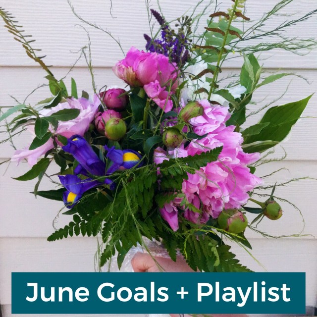 """A bouquet of flowers held in front of a wall with the text """"June Goals + Playlist"""" over it."""