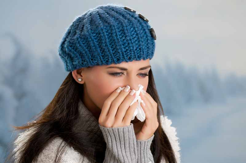 Apotex: woman blowing nose
