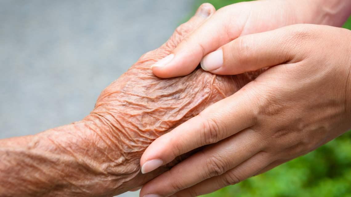 dementia-friendly communities: older hand held by younger hands