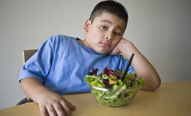 overweight boy with salad