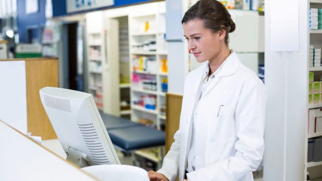 pharmacist on computer