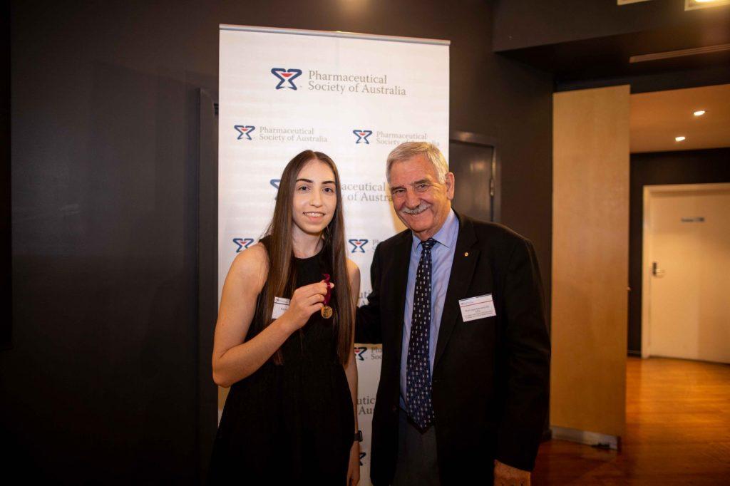 Karissa Searle receives the 2017 PSA Gold Medal from Emeritus Professor Lloyd Sansom AO