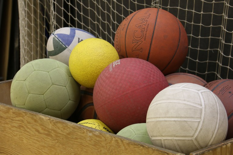 Variety of balls available for community use at the Big Gym, including for volleyball, kickball, dodgeball, basketball, futsal, and rugby.