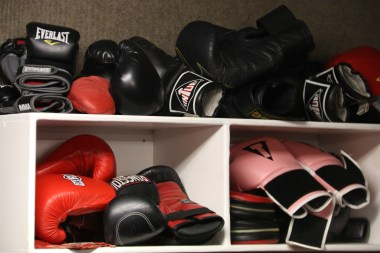 Variety of boxing gloves in the Gerbil Gym's stretching and boxing room.