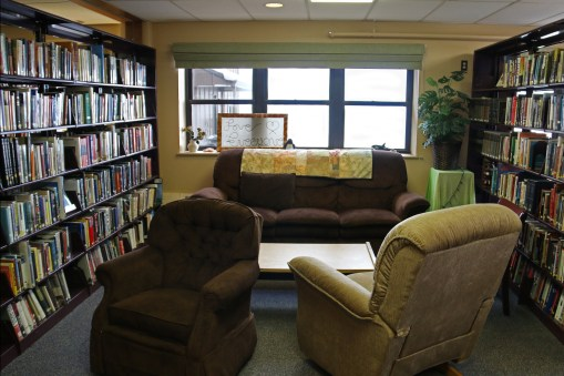 Community lounging and reading area in the McMurdo Library, at the main entrance.