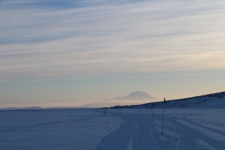 The austral sun begins to dip below the horizon. Mt. Discovery looms in the distance. © A. Padilla